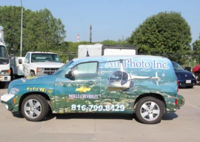 Driver's side of car wrap for Air Photo Inc.