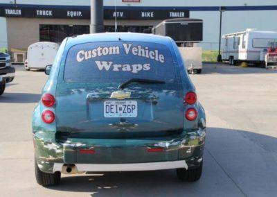 Rear view of a car wrap for Air Photo Inc.