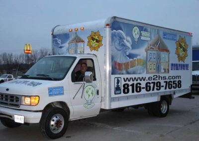 View of AKA Energy box truck wrap from driver's side